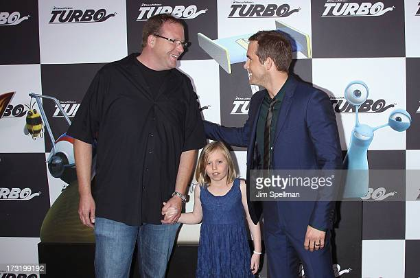 """Actor Ryan Reynolds with brother and niece attend the """"Turbo"""" New York Premiere at AMC Loews Lincoln Square on July 9, 2013 in New York City."""