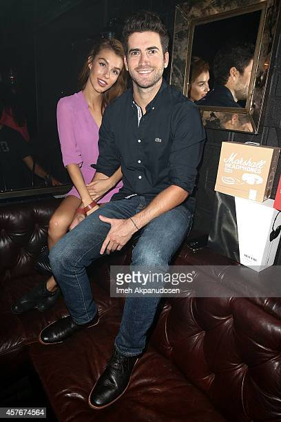 Actor Ryan Rottman and model Jessica Vargas attend the Timberland Fall 2014 concert event featuring Young the Giant at The Sayers Club on October 21...