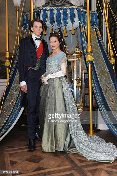 Actor Sabin Tambrea and actress Hannah Herzsprung pose during the Ludwig II Set Visit at the Bavaria Film Studios on October 19 2011 in Munich Germany