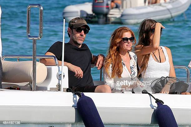 Actor Sacha Baron Cohen and his wife Isla Fisher leave the 'Club 55' on August 19 2015 in SaintTropez France