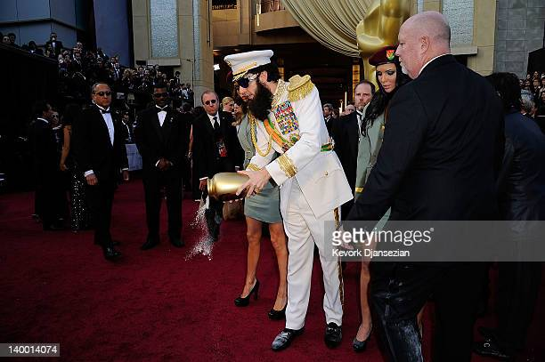Actor Sacha Baron Cohen dressed as his character 'General Aladeen' arrives at the 84th Annual Academy Awards held at the Hollywood Highland Center on...