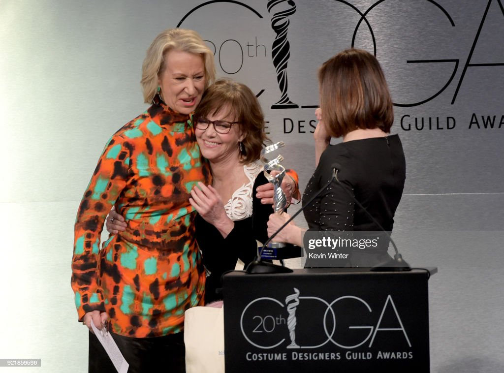 Actor Sally Field and producer Kathleen Kennedy present honoree Joanna Johnston (L) with the Career Achievement Award onstage during the Costume Designers Guild Awards at The Beverly Hilton Hotel on February 20, 2018 in Beverly Hills, California.
