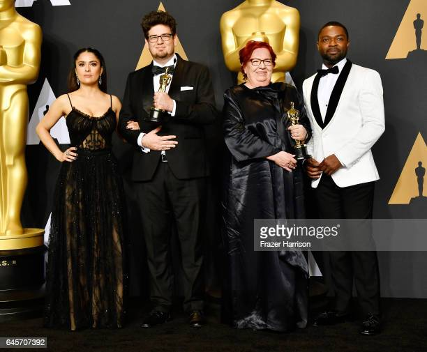 Actor Salma Hayek, director Kristof Deak and producer Anna Udvardy, winners of Best Live Action Short Film for 'Sing' and actor David Oyelowo pose in...