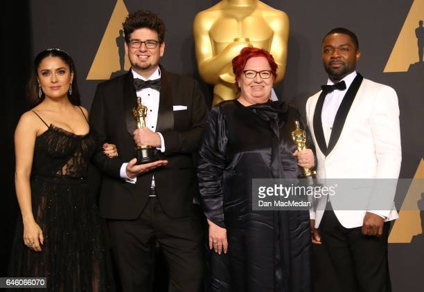 Actor Salma Hayek, director Kristof Deak and producer Anna Udvardy, winners of Best Live Action Short Film for 'Sing' and actor David Oyelow pose in...