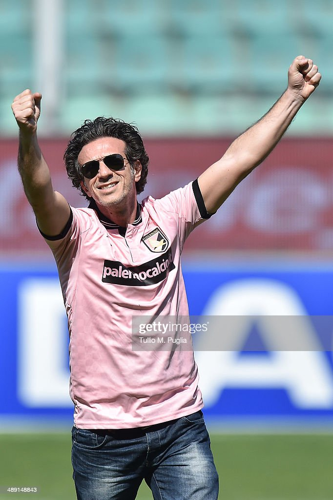Actor Salvo Ficarra, supporter of Palermo, celebrates their promotion during the Serie B match between US Citta di Palermo and SS Virtus Lanciano at Stadio Renzo Barbera on May 10, 2014 in Palermo, Italy.