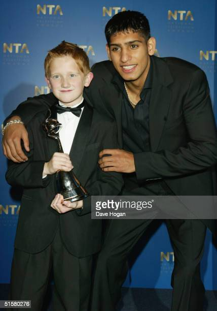 Actor Sam Aston and boxer Amir Khan pose in the Awards Room with the award for Most Popular Newcomer at the 10th Anniversary National Television...