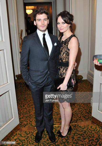Actor Sam Claflin and actress Laura Haddock attend the Jameson Empire Awards 2012 at Grosvenor House, on March 25, 2012 in London, England.