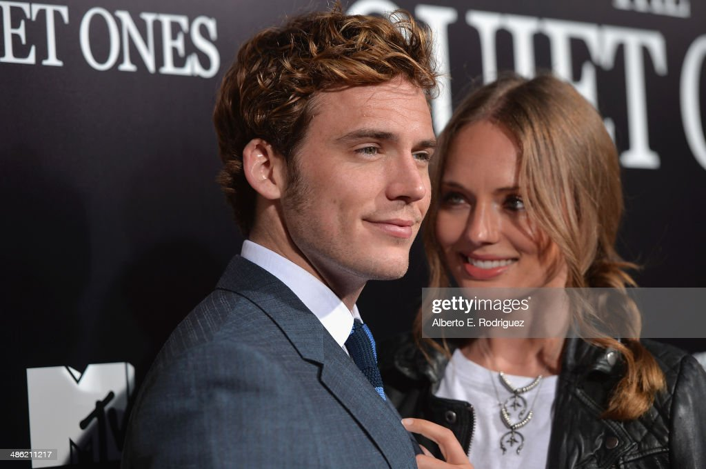 Actor Sam Claflin and Laura Haddock arrive to the Los Angeles Premiere of Lionsgate Films' 'The Quiet Ones' at The Theatre At Ace Hotel on April 22, 2014 in Los Angeles, California.