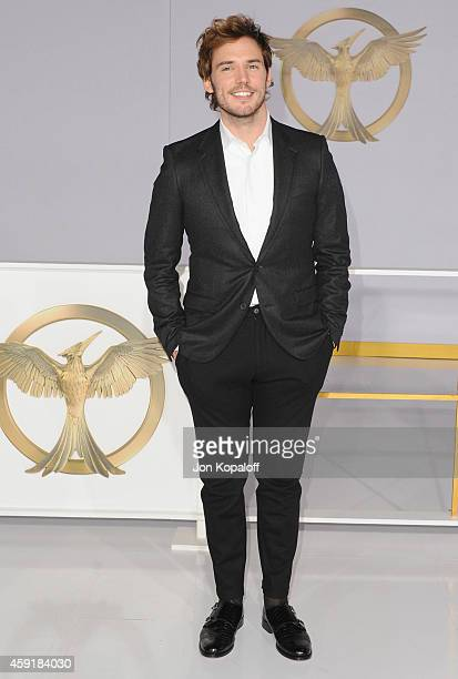 Actor Sam Claflin arrives at the Los Angele Premiere The Hunger Games Mockingjay Part 1 at Nokia Theatre LA Live on November 17 2014 in Los Angeles...