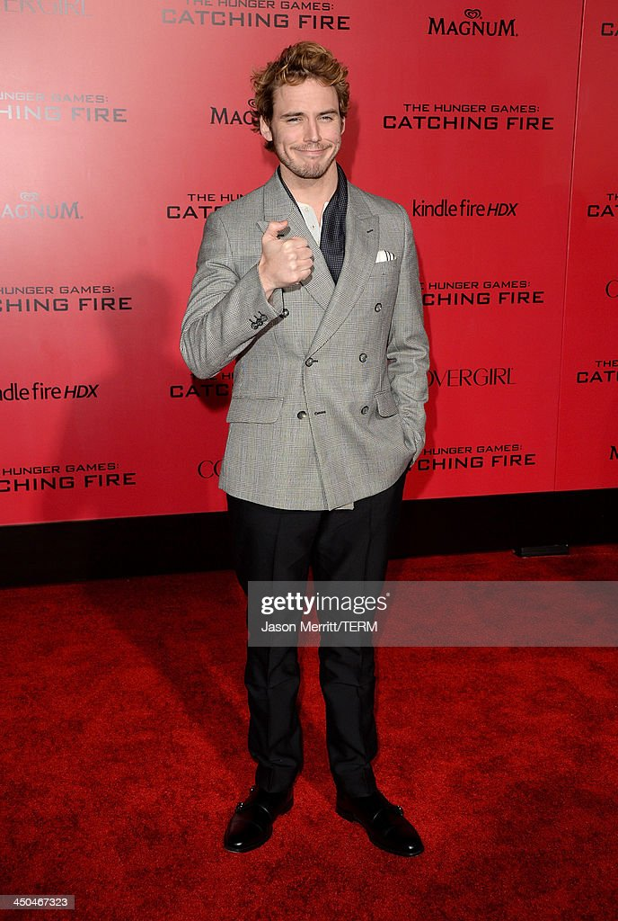 Actor Sam Claflin arrives at the premiere of Lionsgate's 'The Hunger Games: Catching Fire' at Nokia Theatre L.A. Live on November 18, 2013 in Los Angeles, California.