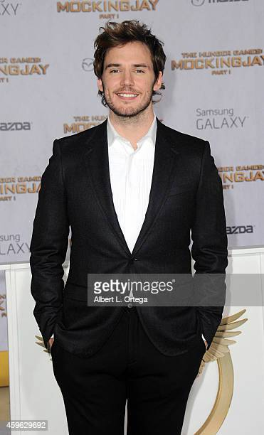 Actor Sam Claflin arrives for the Premiere Of Lionsgate's The Hunger Games Mockingjay Part 1 Arrivals held at Nokia Theatre LA Live on November 17...