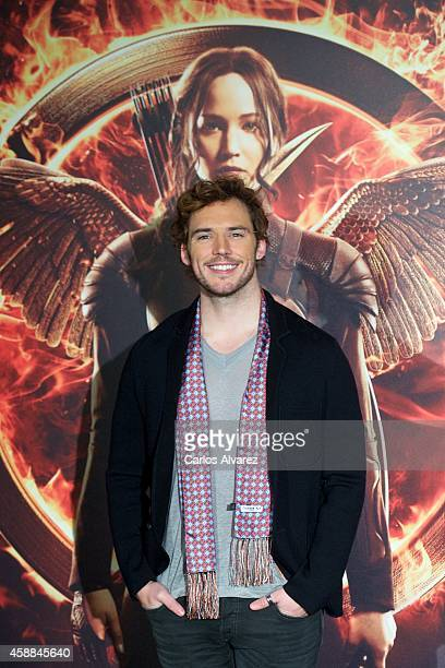 Actor Sam Claflin attends the 'The Hunger Games Mockingjay Part 1' photocall at the Villamagna Hotel on November 12 2014 in Madrid Spain