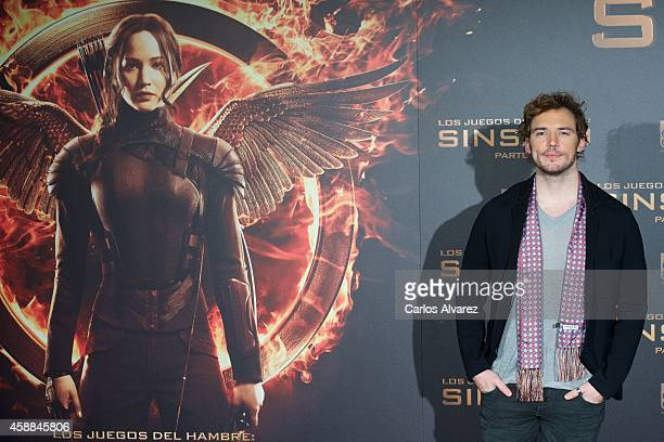 """Actor Sam Claflin attends the """"The Hunger Games: Mockingjay Part 1"""" photocall at the Villamagna Hotel on November 12, 2014 in Madrid, Spain."""