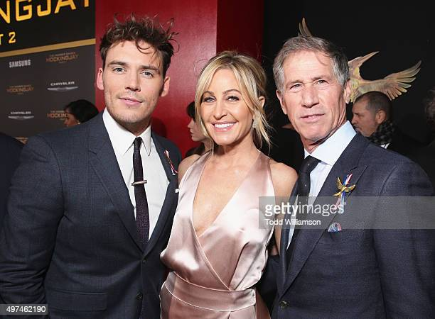 Actor Sam Claflin Laurie Feltheimer and Lionsgate CEO Jon Feltheimer attend premiere of Lionsgate's The Hunger Games Mockingjay Part 2 at Microsoft...