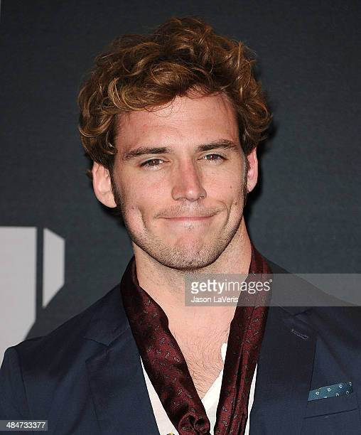 Actor Sam Claflin poses in the press room at the 2014 MTV Movie Awards at Nokia Theatre LA Live on April 13 2014 in Los Angeles California