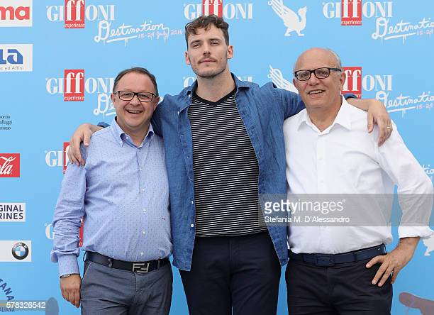 Actor Sam Claflin President Pietro Rinaldi with Artistic Director Claudio Gubitosi attend the Giffoni Film Festival Day 7 blue photocall on July 21...