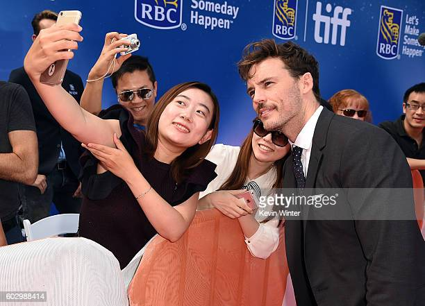 """Actor Sam Claflin takes a selfie with a fan during the """"Their Finest"""" premiere during the 2016 Toronto International Film Festival at Roy Thomson..."""