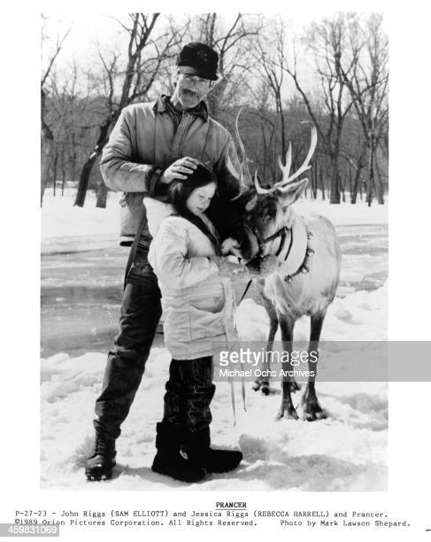 """Actor Sam Elliott and actress Rebecca Harrell Tickell on the set of the movie """"Prancer """" , circa 1989."""