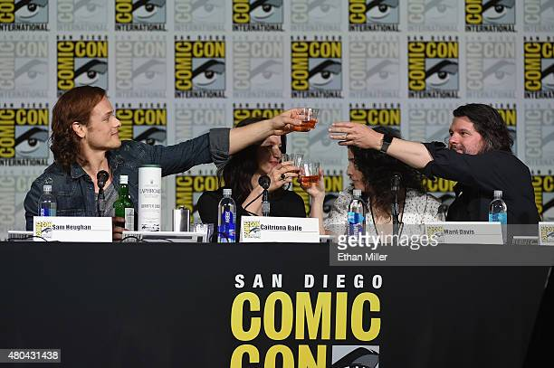"""Actor Sam Heughan, actress Caitriona Balfe, producer Maril Davis and writer/producer Ronald D. Moore share a toast at the Starz: """"Outlander"""" panel..."""