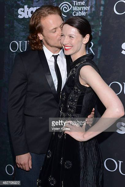 """Actor Sam Heughan and actress Caitriona Balfe attend the Starz Series """"Outlander"""" Premiere - Comic-Con International 2014 at Spreckels Theatre on..."""