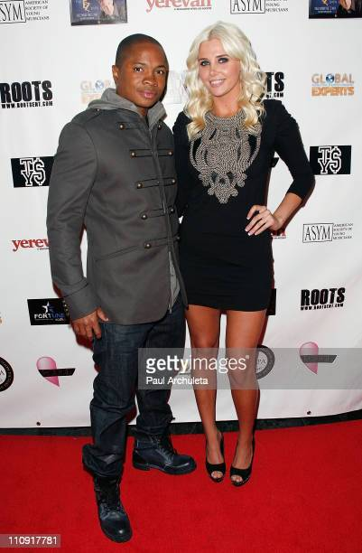 Actor Sam Jones III and Playboy playmate Karissa Shannon arrive at the Hollywood music showcase and fundraiser benefiting American Red Cross relief...