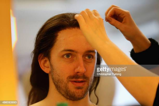 Actor Sam Marks, who plays Ned Poins, has a wig applied for the matinee performance of Henry IV Part 1 on April 22, 2014 in Stratford-Upon-Avon,...