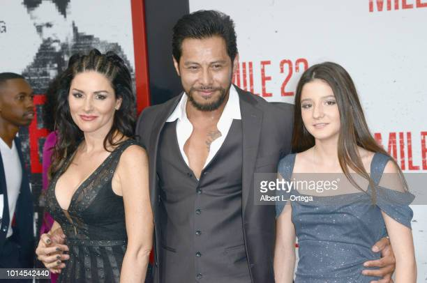 Actor Sam Medina with wofe Claire and daughter Dawn arrive for the Premiere Of STX Films' 'Mile 22' held at Westwood Village Theatre on August 9 2018...