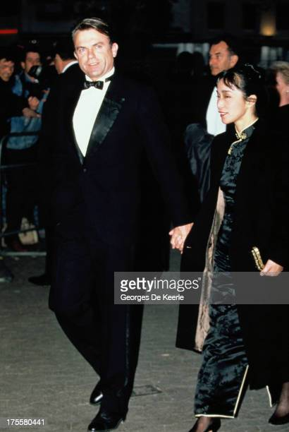 Actor Sam Neill and his wife Noriko Watanabe attend the premiere of 'The Hunt for Red October' at Odeon cinema on April 18 1990 in London England