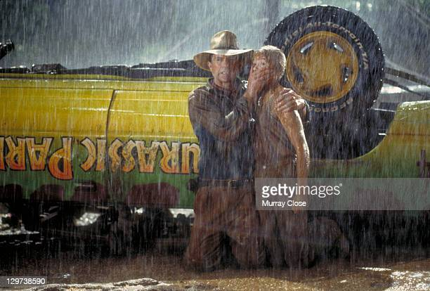 Actor Sam Neill as Dr Alan Grant and Ariana Richards as Lex try to avoid the attentions of a Tyrannosaurus Rex in a scene from the film 'Jurassic...