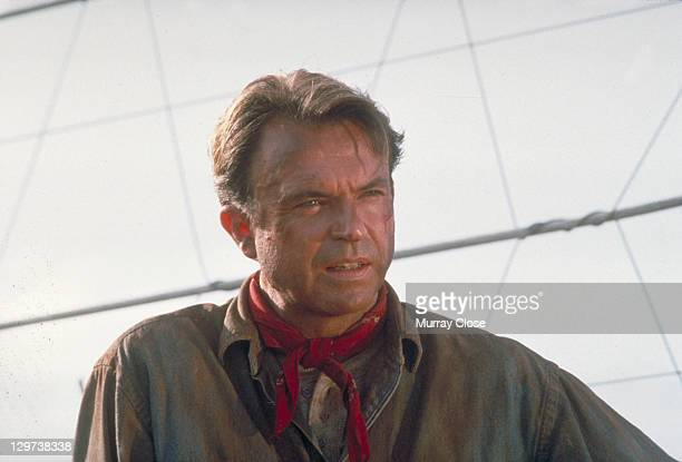 Actor Sam Neill as Dr Alan Grant next to an electric fence in a scene from the film 'Jurassic Park' 1993