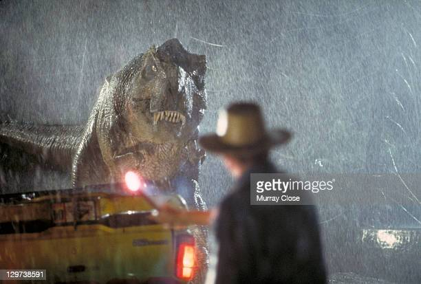 Actor Sam Neill as Dr Alan Grant takes on a Tyrannosaurus Rex in a scene from the film 'Jurassic Park' 1993