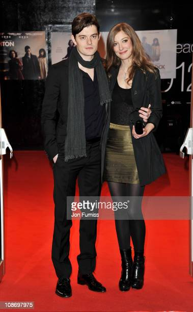 Actor Sam Riley and wife Alexandra Maria Lara attends the European Premiere of Brighton Rock at Odeon West End on February 1 2011 in London England