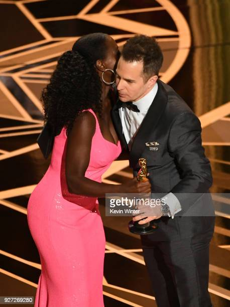 Actor Sam Rockwell accepts Best Suppoorting Actor for 'Three Billboards Outside Ebbing Missouri' from actor Viola Davis onstage at the 90th Annual...