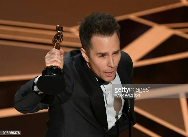Actor Sam Rockwell accepts the Oscar for Best Supporting Actor in Three Billboards outside Ebbing Missouri during the 90th Annual Academy Awards show...