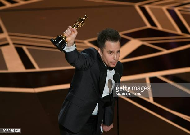 TOPSHOT Actor Sam Rockwell accepts the Oscar for Best Supporting Actor in Three Billboards outside Ebbing Missouri during the 90th Annual Academy...