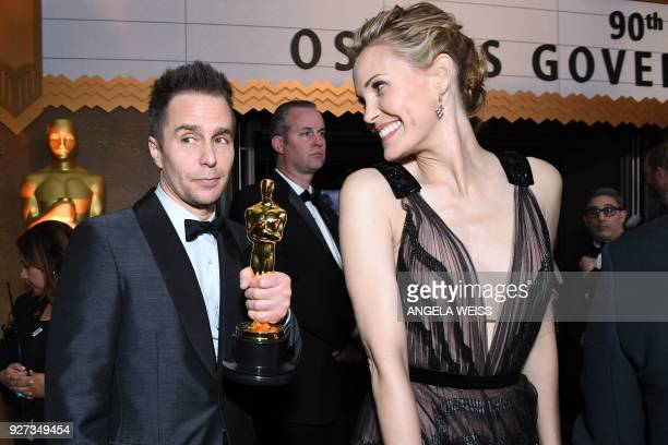 US actor Sam Rockwell and his wife Leslie Bibb attend the 90th Annual Academy Awards Governors Ball at the Hollywood Highland Center on March 4 in...