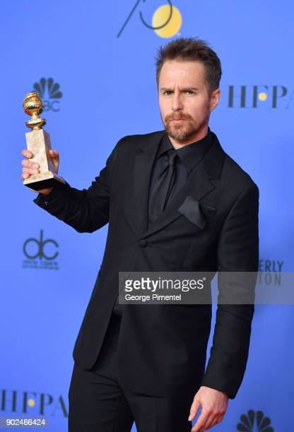 Actor Sam Rockwell holds his award for Best Performance by an Actor in a Supporting Role in any Motion Picture poses in the press room during the...