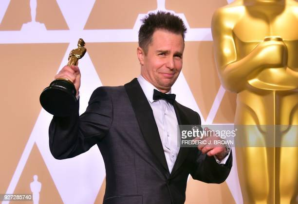 TOPSHOT Actor Sam Rockwell poses in the press room with the Oscar for Best Actor in Supporting Role during the 90th Annual Academy Awards on March 4...