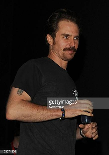 Actor Sam Rockwell walks onstage at the 'Cowboys Aliens' panel discussion during ComicCon 2010 at San Diego Convention Center on July 24 2010 in San...