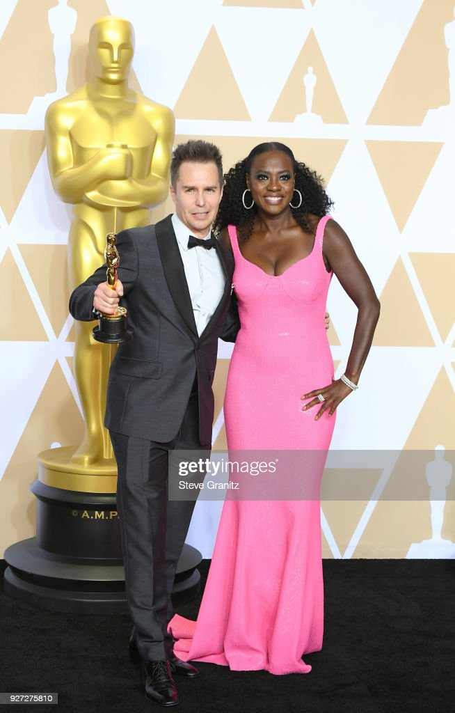 Actor Sam Rockwell (L), winner of the Best Supporting Actor award for 'Three Billboards Outside Ebbing, Missouri,' and actor Viola Davis, wearing Michael Kors pose in the press room during the 90th Annual Academy Awards at Hollywood & Highland Center on March 4, 2018 in Hollywood, California.