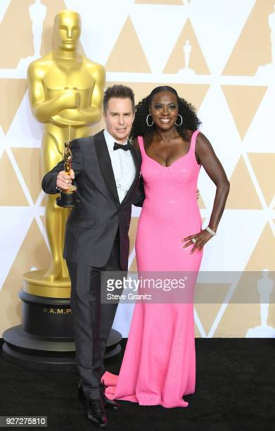 Actor Sam Rockwell winner of the Best Supporting Actor award for 'Three Billboards Outside Ebbing Missouri' and actor Viola Davis wearing Michael...