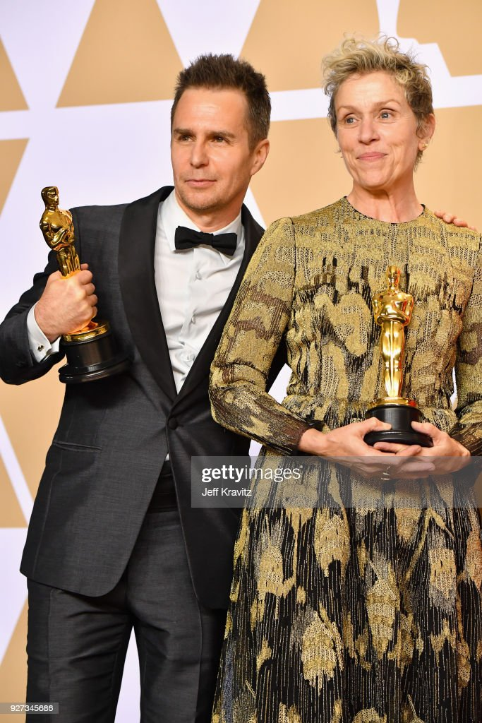 Actor Sam Rockwell, winner of the Best Supporting Actor award for 'Three Billboards Outside Ebbing, Missouri', actor Frances McDormand, winner of the Best Actress award for 'Three Billboards Outside Ebbing, Missouri' poses in the press room during the 90th Annual Academy Awards at Hollywood & Highland Center on March 4, 2018 in Hollywood, California.