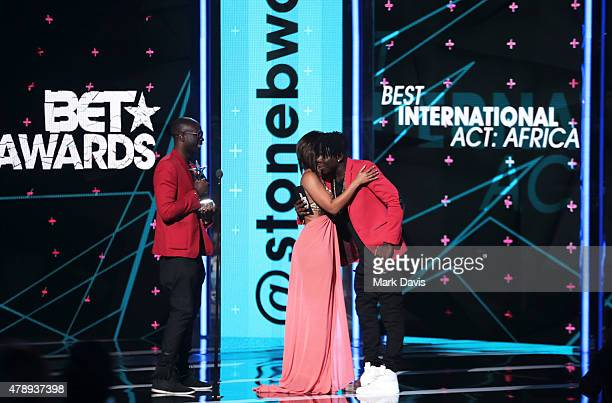 Actor Sam Sarpong TV personality Minnie Dlamini and recording artist Stonebwoy speak onstage during the International Awards during the 2015 BET...