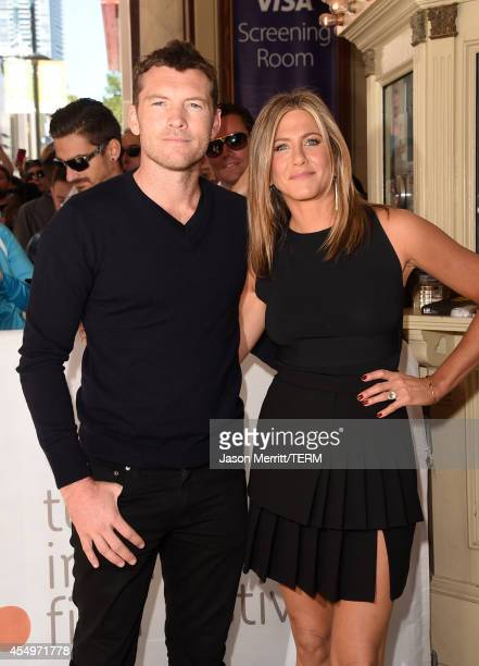 Actor Sam Worthington and actress/executive producer Jennifer Aniston attend the 'Cake' premiere during the 2014 Toronto International Film Festival...