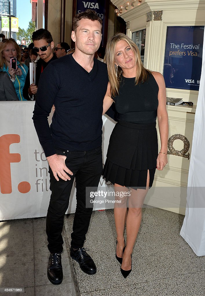 Actor Sam Worthington (L) and actress/executive producer Jennifer Aniston attend the 'Cake' premiere during the 2014 Toronto International Film Festival at The Elgin on September 8, 2014 in Toronto, Canada.