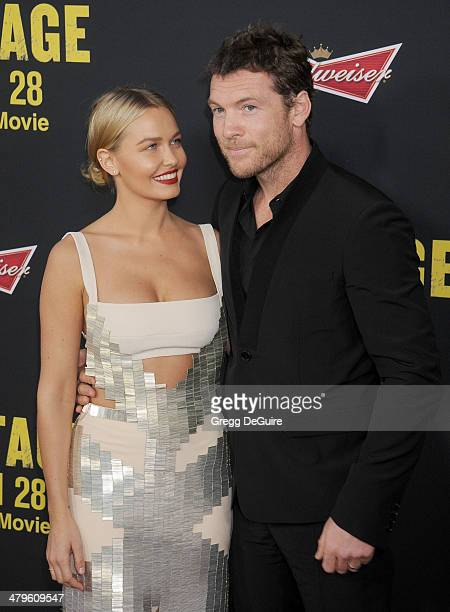 Actor Sam Worthington and Lara Bingle arrive at the Los Angeles premiere of 'Sabotage' at Regal Cinemas LA Live on March 19 2014 in Los Angeles...