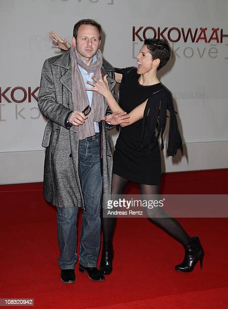 Actor Samuel Finzi and actress Jasmin Gerat arrive for the ''Kokowaeaeh' Germany Premiere at CineStar on January 25 2011 in Berlin Germany