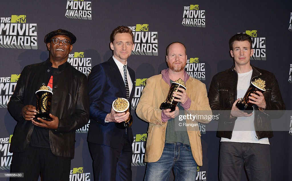 Actor Samuel L. Jackson, actor Tom Hiddleston, filmmaker Joss Wedon and actor Chris Evans pose backstage during the 2013 MTV Movie Awards at Sony Pictures Studios on April 14, 2013 in Culver City, California.