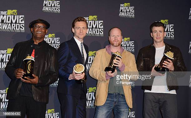 Actor Samuel L Jackson actor Tom Hiddleston filmmaker Joss Wedon and actor Chris Evans pose backstage during the 2013 MTV Movie Awards at Sony...