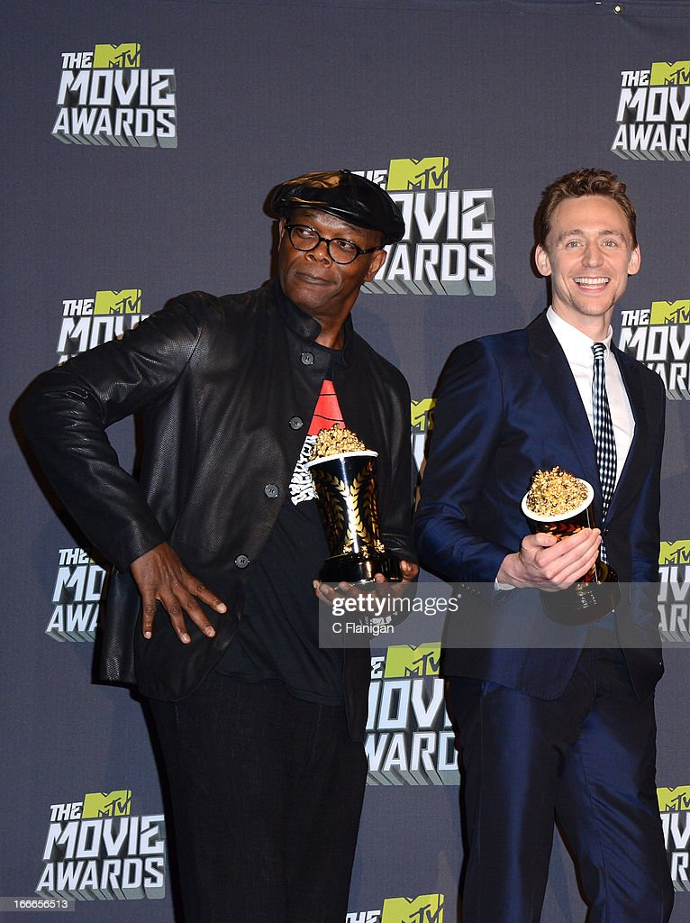 Actor Samuel L. Jackson and actor Tom Hiddleston pose backstage during the 2013 MTV Movie Awards at Sony Pictures Studios on April 14, 2013 in Culver City, California.